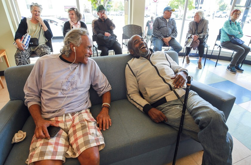 Carl Russell, 72, and Victor Quslan, 62, relax in the community room at the Gary and Mary West Senior Wellness Center