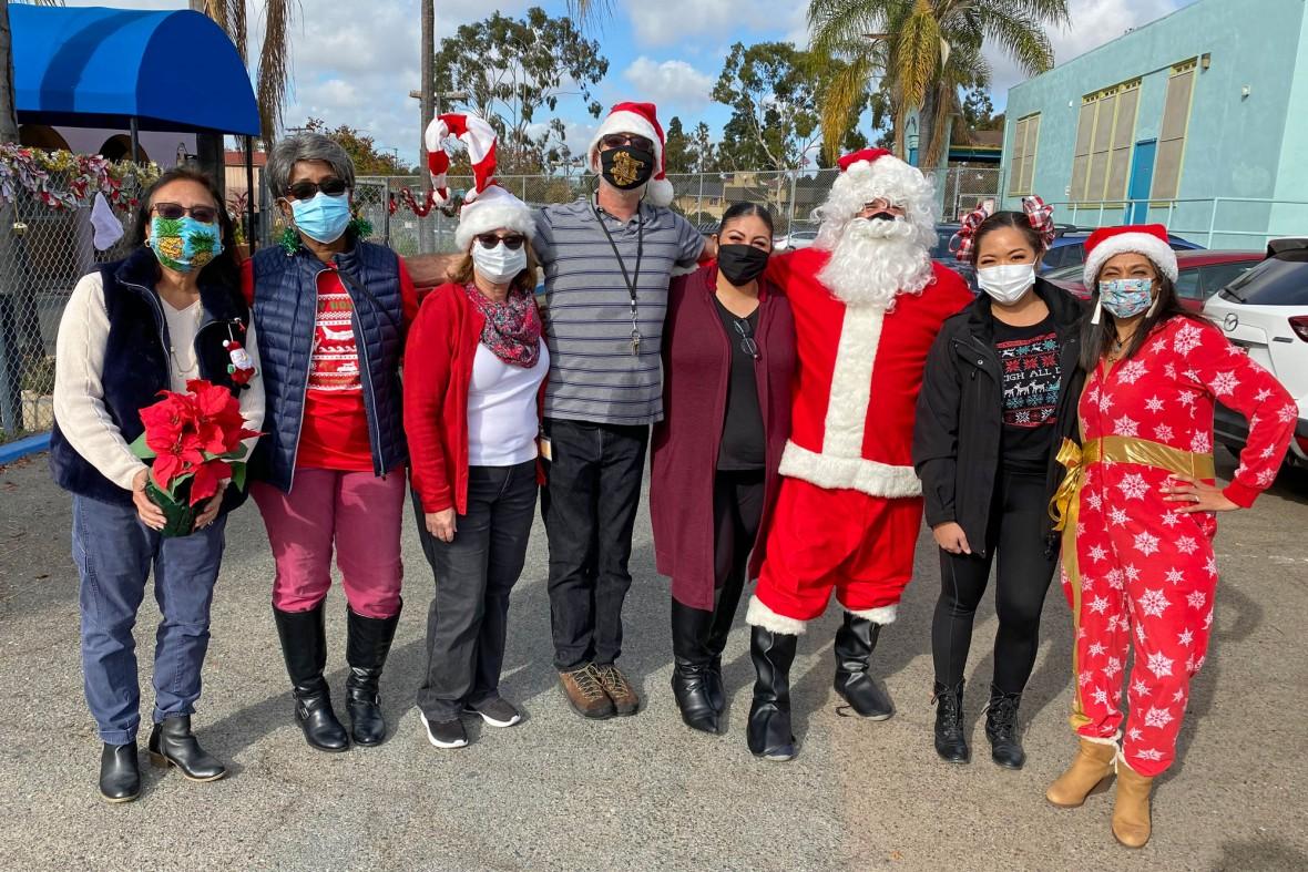 Neighborhood House Association Senior Center staff and volunteers bring holiday cheer to local seniors