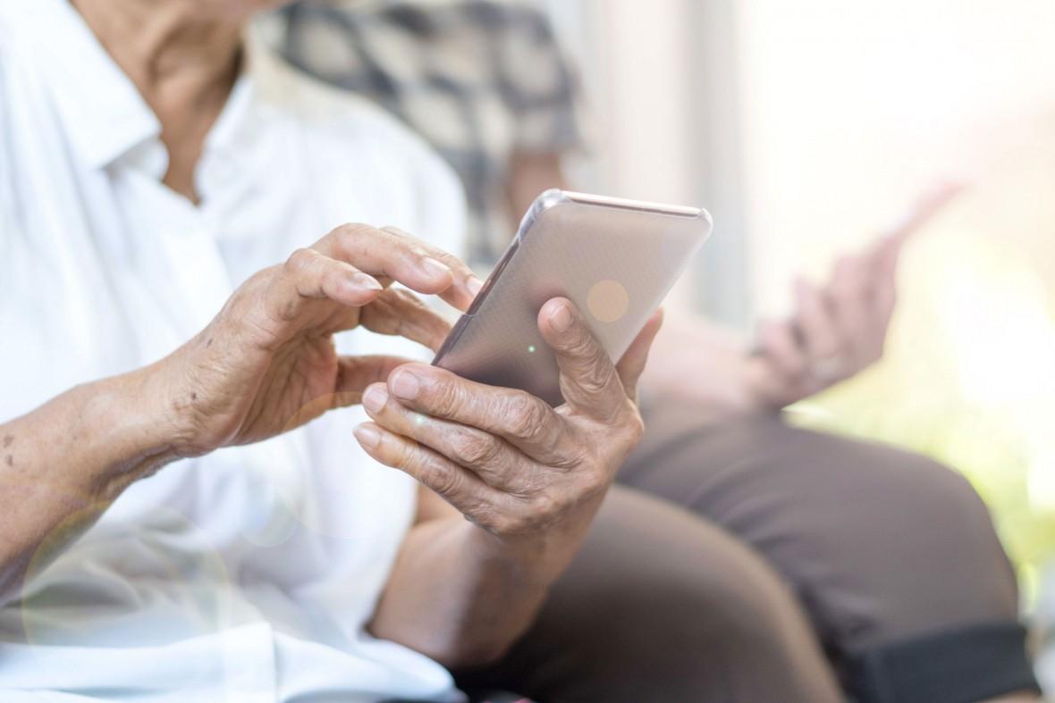senior couple using smart phones